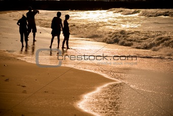Beach with Silhouette people