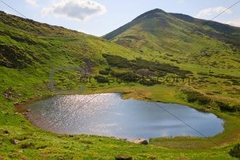 Alpine lake Nesamovyte on summer mountains