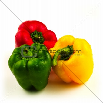 Three sweet peppers on white