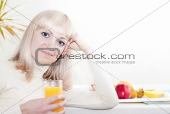 Beautiful woman has a breakfast in the kitchen