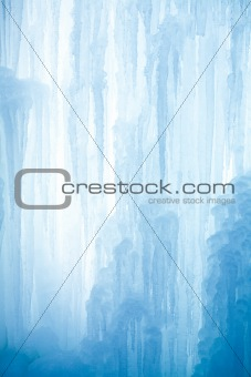 A frozen waterfall with ice in a blue and white color in winter