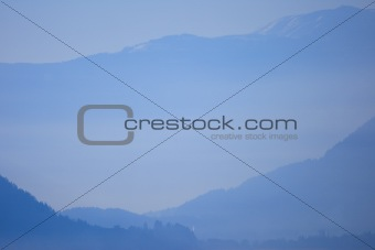 Alps in Austria in a blue evening fog