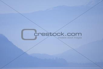 Alps in Austria in a blue evening fog