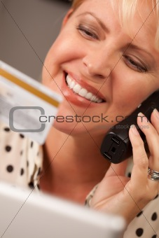 Beautiful Woman on the Phone Holding Her Credit Card.