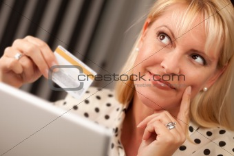 Beautiful Woman on Her Laptop Holding Her Credit Card.