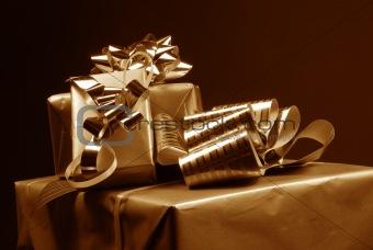 Three gift boxes on dark background