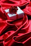 gift box on red satin background