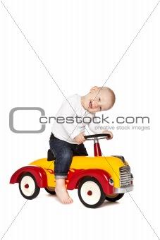 Boy riding his toycar