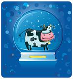 cow inside of the snow-dome