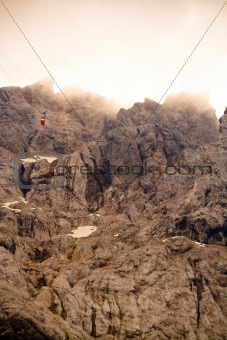 Cable car above rocks