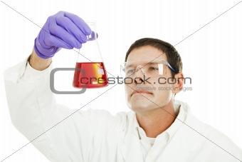 Scientist Examines Liquid Compound