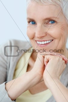 Happy pretty elderly woman smiling