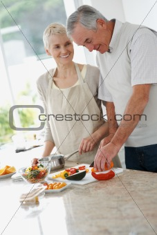Senior couple preparing a meal