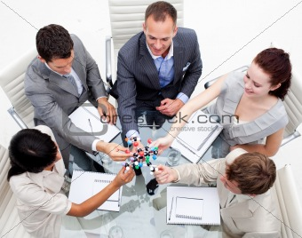 Business team examining molecules in the office