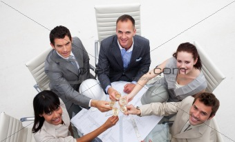 Group of architects celebrating a success in the office