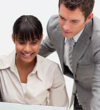 Businesswoman and businessman working together in an office