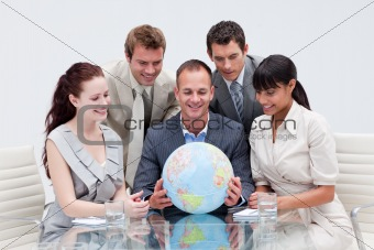 Business team holding the world. Global expansion