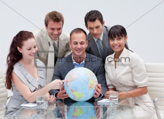 Business team holding a terrestrial globe. Worldwide business