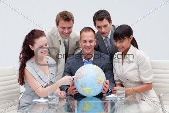 Business team holding a terrestrial globe. International busines