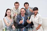 Business team celebrating a success with champagne in the office
