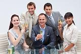 Business team toasting with champagne in the office