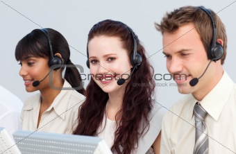 Beautiful woman working with her team in a call center