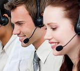 Portrait of people with a headset on in a call center
