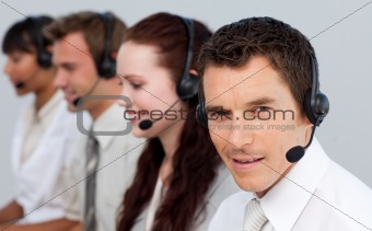 Attractive man working with his team in a call center