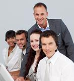 Young multi-ethnic business team working with computers in an office