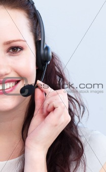 Portrait of smiling attractive woman with a headset on