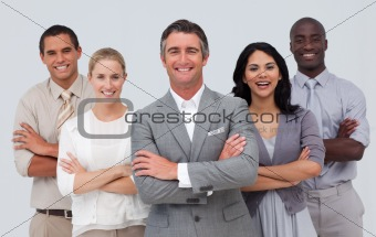 Smiling business team standing against white background