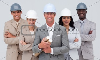 Architectural team smiling at the camera with hard hats
