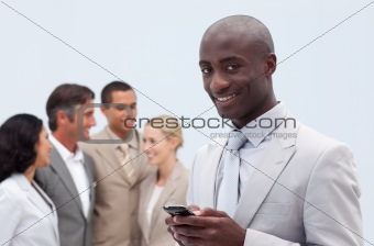 Smiling Afro-American businessman sending a message