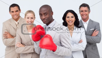 Afro-American businessman with boxing gloves leading his team