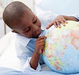 Small boy looking at a Globe
