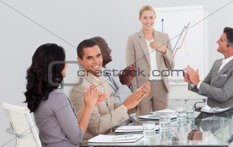 Businesswoman standing smilling after a presentation