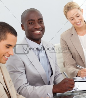 Business People Smiling in a meeting