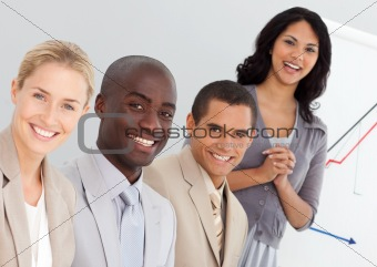 Smiling business team sitting in a meeting in the office