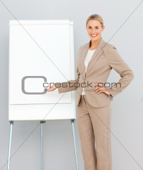 Businesswoman Standing  pointing at a whiteboard