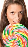Pretty young Hispanic woman with lollipop