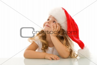Little girl daydreaming of christmas