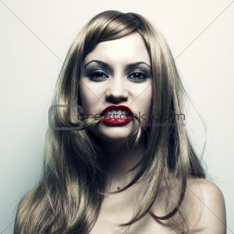 Young woman with hair in a mouth