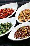 Assorted herbal wellness dry tea in bowls