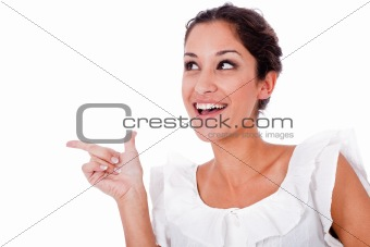 Close up portrait of a happy young woman pointing up at copyspac
