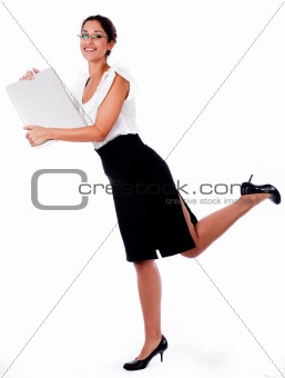Business Woman raise his left leg with laptop