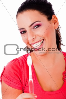 beautiful young woman holding tooth brush and smiling