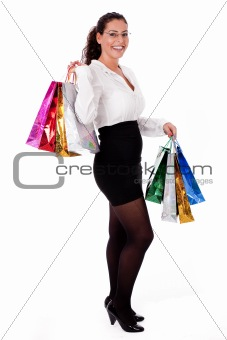 Beautiful young trendy woman smiling with shopping bag