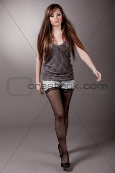 Cute young model walking