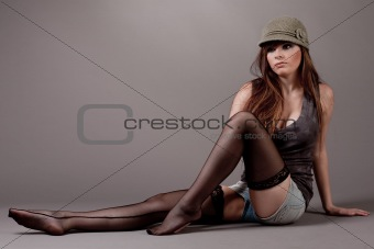 Beautiful young model sitting on the floor
