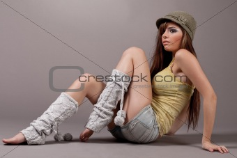Pretty female model sitting and woolen leggings